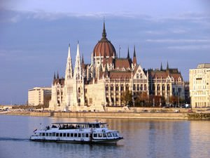 Parliament Building and Cruise Boat along Danube River at Sunset - From Buda Side